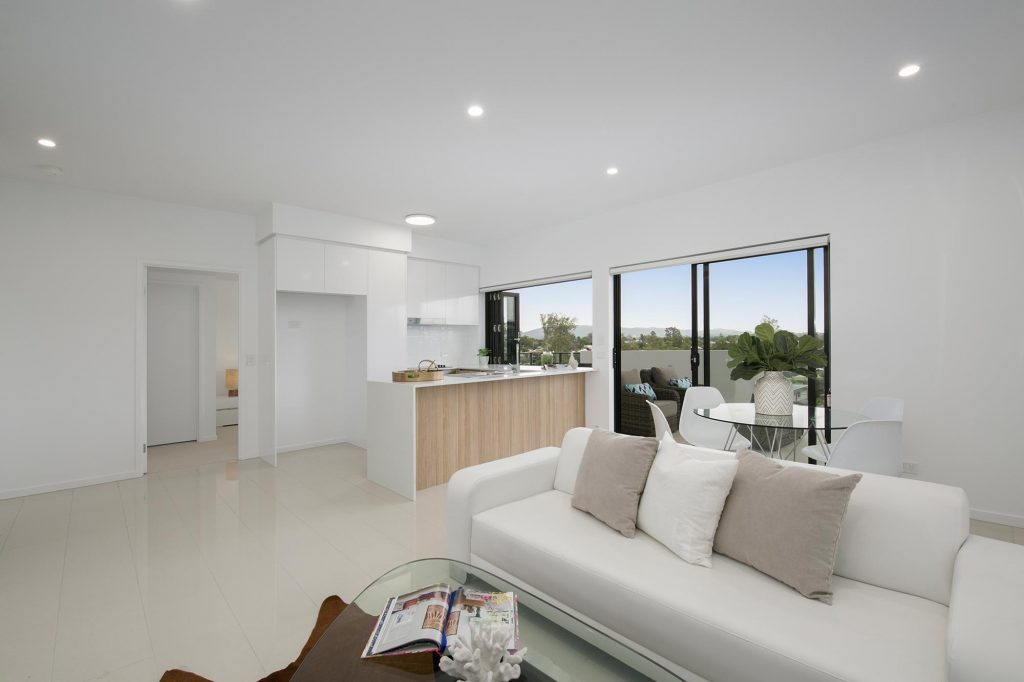 56 Hood St, Sherwood: Well-lit and naturally ventilated open planned living areas with polished ceramic tiling and high ceilings