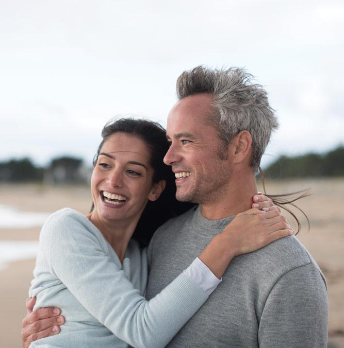 Couple on beach investors
